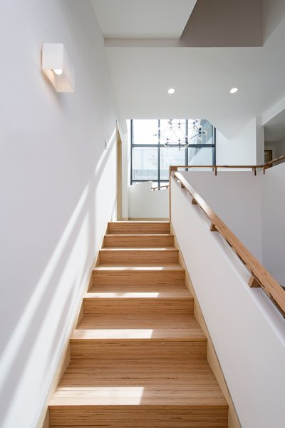 Modern home with staircase, wood tread, and wood railing. Stair 2 Photo 6 of A House