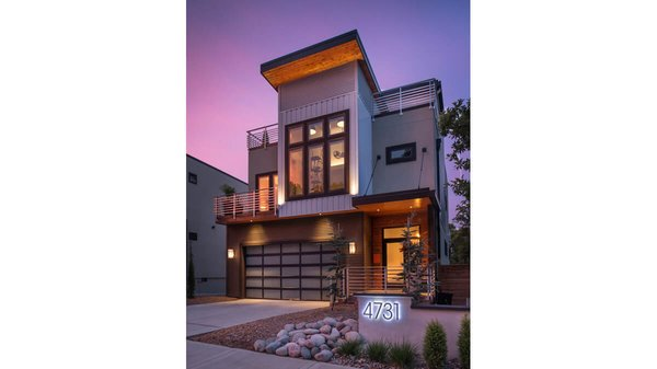 View at dusk of front exterior of a two-story modern home in Kansas City, Missouri.  Photo  of Artistically Modern modern home