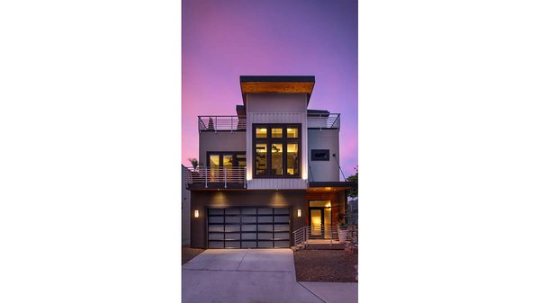 Exterior of house at dusk. Photo 17 of Artistically Modern modern home