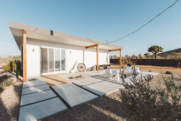 Modern home with outdoor and wood patio, porch, deck. Photo  of A Serenity Escape in Joshua Tree