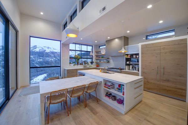 Panoramic Kitchen views of the snow covered mountains in Salt Lake City, UT Photo-Aaron Shaw Photo 6 of 529 Avenues Residence modern home