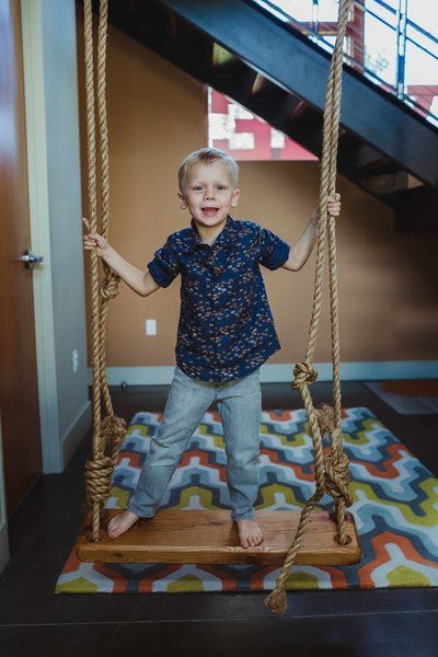 A swing installed in the living room makes use of the space under the stairs … and it's a fun feature for the kids. Photo 8 of 1600 Lakeside modern home