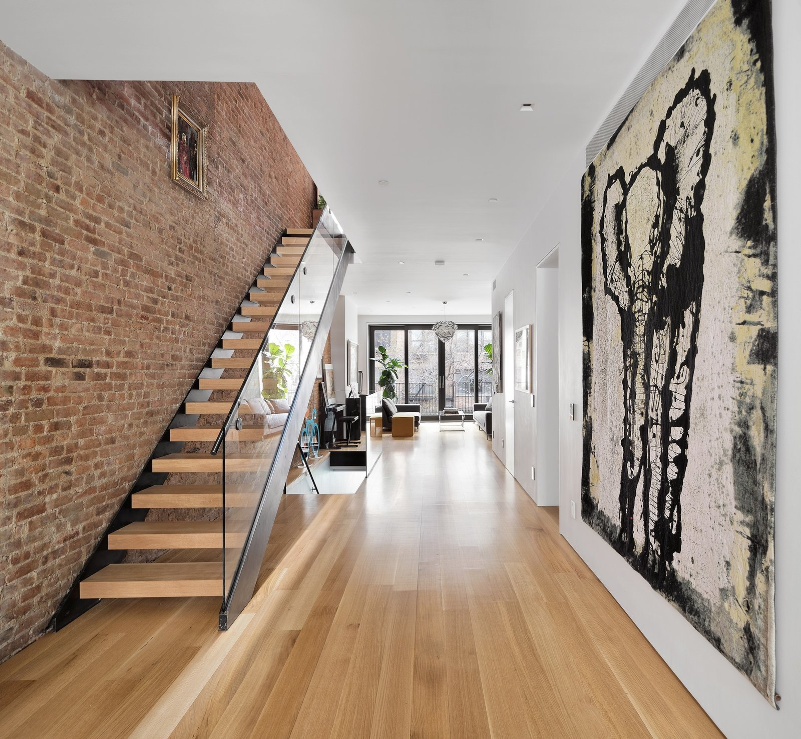Completely open floor plan designed to optimize light and air  Uptown Loft by Danielle Fuerth
