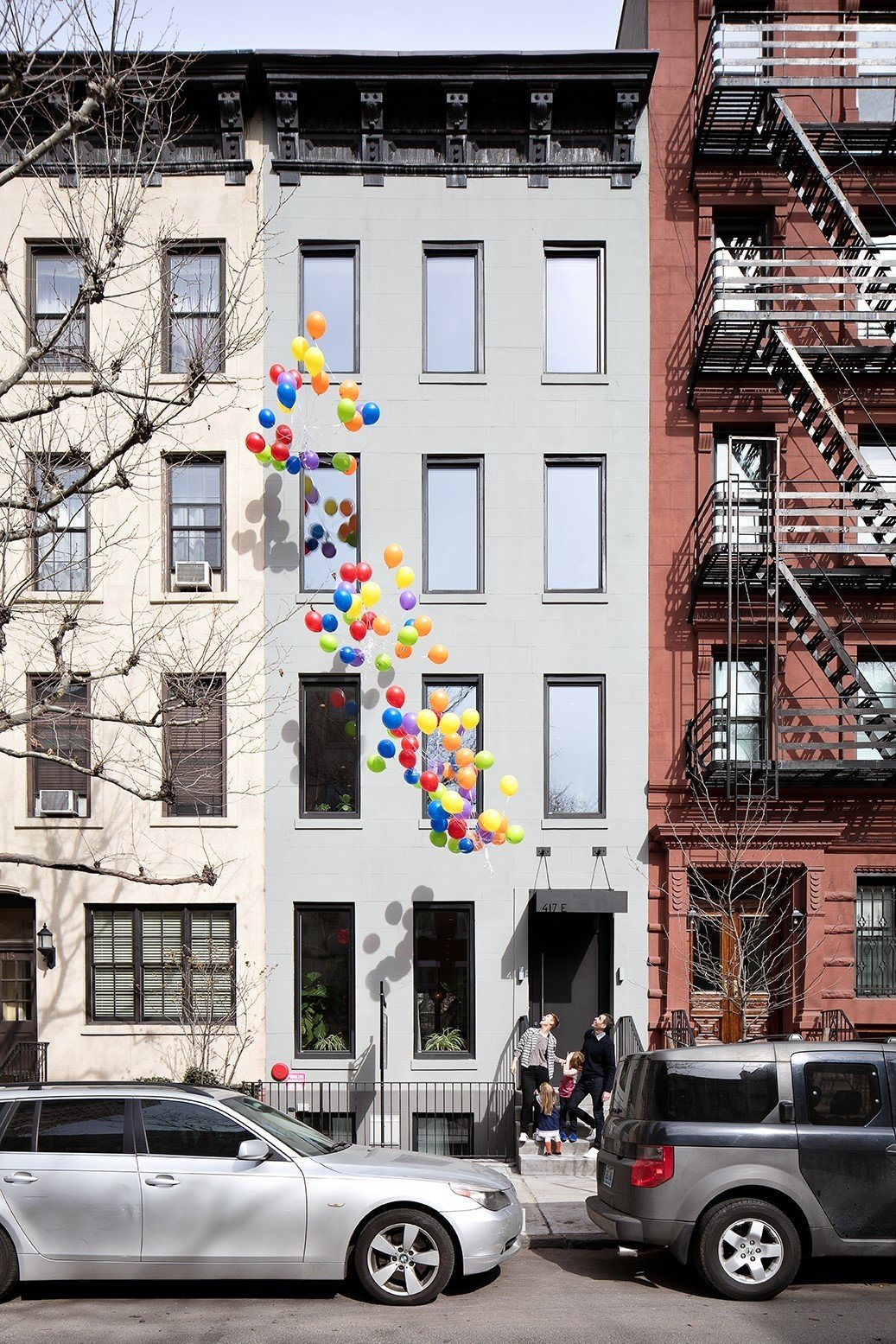 Beautiful facade capturing a nice family moment  Uptown Loft by Danielle Fuerth