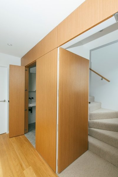 'Secret' doors in wall panelling to bathroom and bedroom Photo 11 of The Narrow House modern home