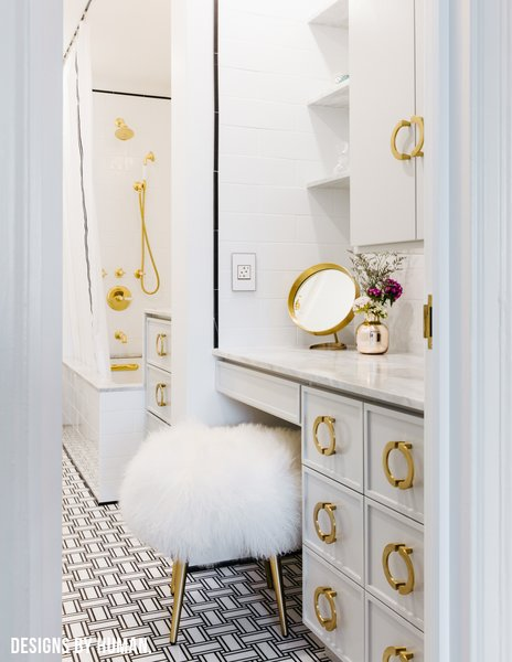 Modern home with bath room, marble counter, marble floor, drop in sink, open shower, drop in tub, ceiling lighting, wall lighting, subway tile wall, marble wall, and two piece toilet. Detail of entrance to Bathroom. Photo 9 of Brooklyn Heights Glam Apartment