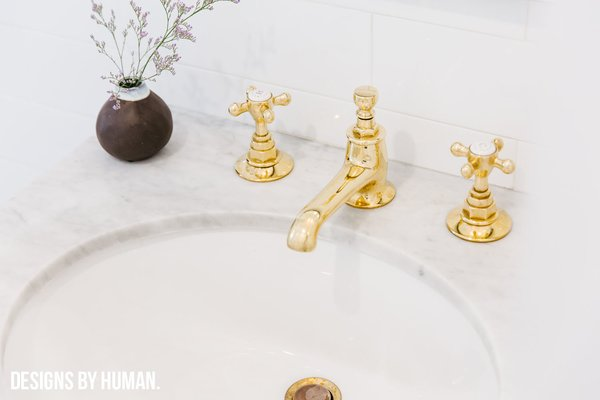Modern home with bath room, marble counter, drop in sink, subway tile wall, and marble wall. Detail of un-lacquered brass fixtures. Photo 2 of Brooklyn Heights Glam Apartment