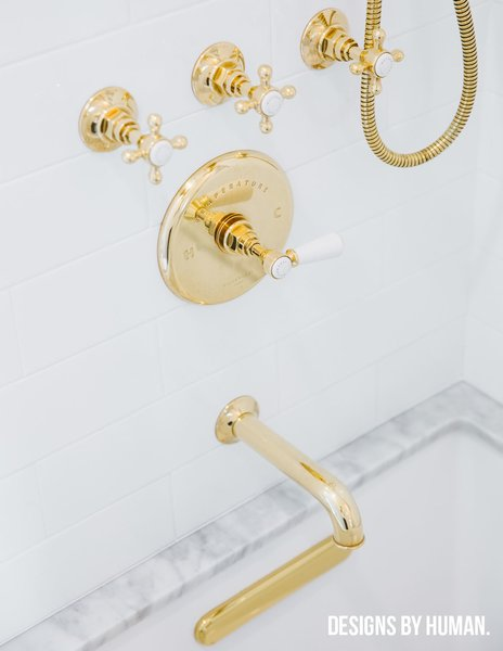 Modern home with bath room, drop in tub, subway tile wall, marble counter, and marble wall. Detail of un-lacquered brass fixtures. Photo 3 of Brooklyn Heights Glam Apartment