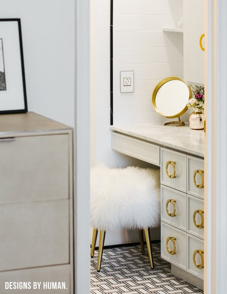 Modern home with bath room, marble counter, marble floor, and drop in sink. Detail of entrance to Bathroom. Photo 8 of Brooklyn Heights Glam Apartment