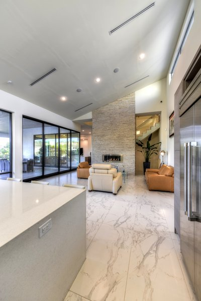 OPEN LIVING KITCHEN AREA Photo 17 of ORVANANOS HOUSE modern home
