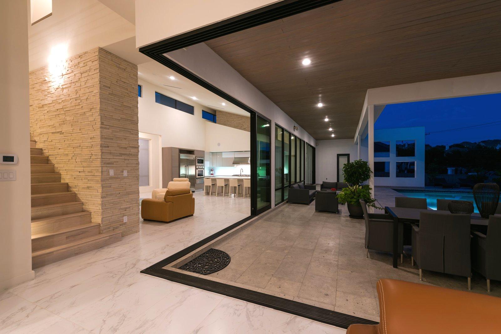 CORNER SLIDING GLASS DOORS  ORVANANOS HOUSE by OSCAR E FLORES DESIGN STUDIO