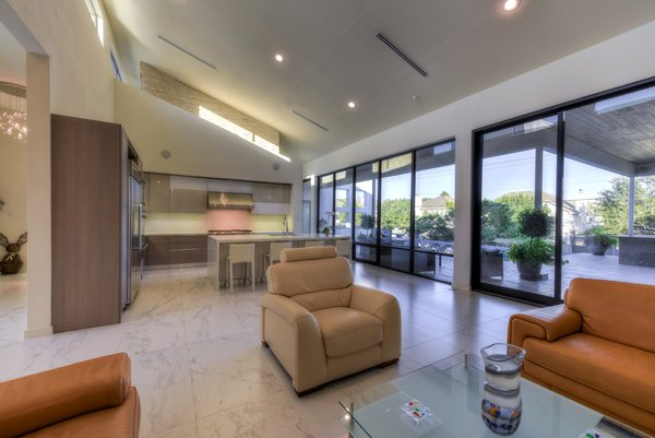 OPEN LIVING KITCHEN AREA Photo 15 of ORVANANOS HOUSE modern home