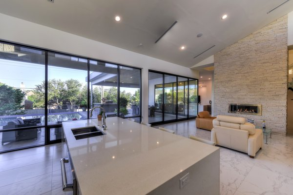 OPEN LIVING KITCHEN AREA Photo 16 of ORVANANOS HOUSE modern home