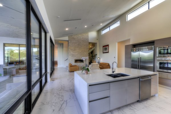 OPEN LIVING KITCHEN AREA Photo 18 of ORVANANOS HOUSE modern home