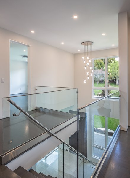 The glass railing system takes full advantage of the bright atrium and view into the large yard beyond. Photo 3 of Shadow on White Pallet modern home