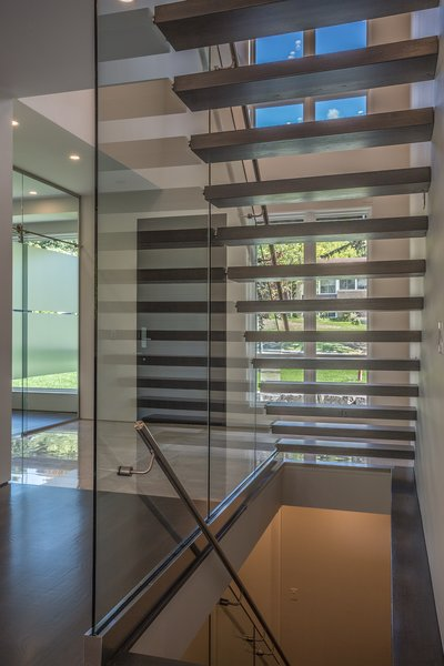Even under the stairs, one has a good view into the yard. Photo 4 of Shadow on White Pallet modern home