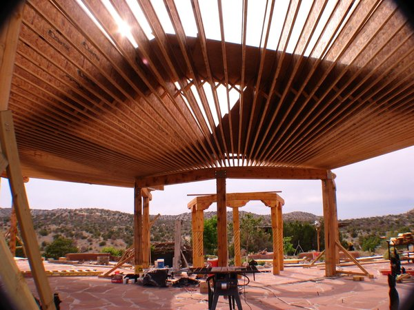 TGI pro 250 roof supports,flagstone floor,New Mexico ponderosa pine post and beams Photo 5 of Picture Rock Studio-Round Strawbale Home design & built by Glen Neff modern home