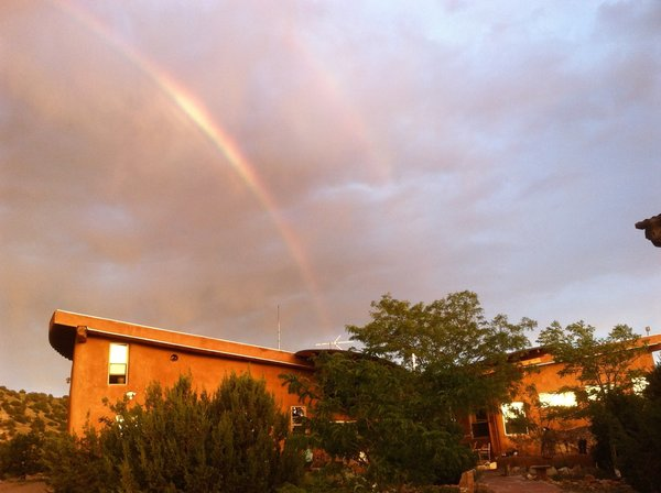 Rainbow over Picture Rock Photo 10 of Picture Rock Studio-Round Strawbale Home design & built by Glen Neff modern home