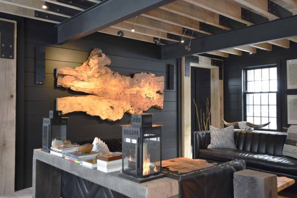 "Exposed Oak and Steel Frame.  Large silver Maple slab for display, lanterns, low voltage lighting, leather seating/sofas from ""Of Iron & Oak"", huge oak passage ways, Kef stereo systems.  The Lodge by Alpha Genesis"