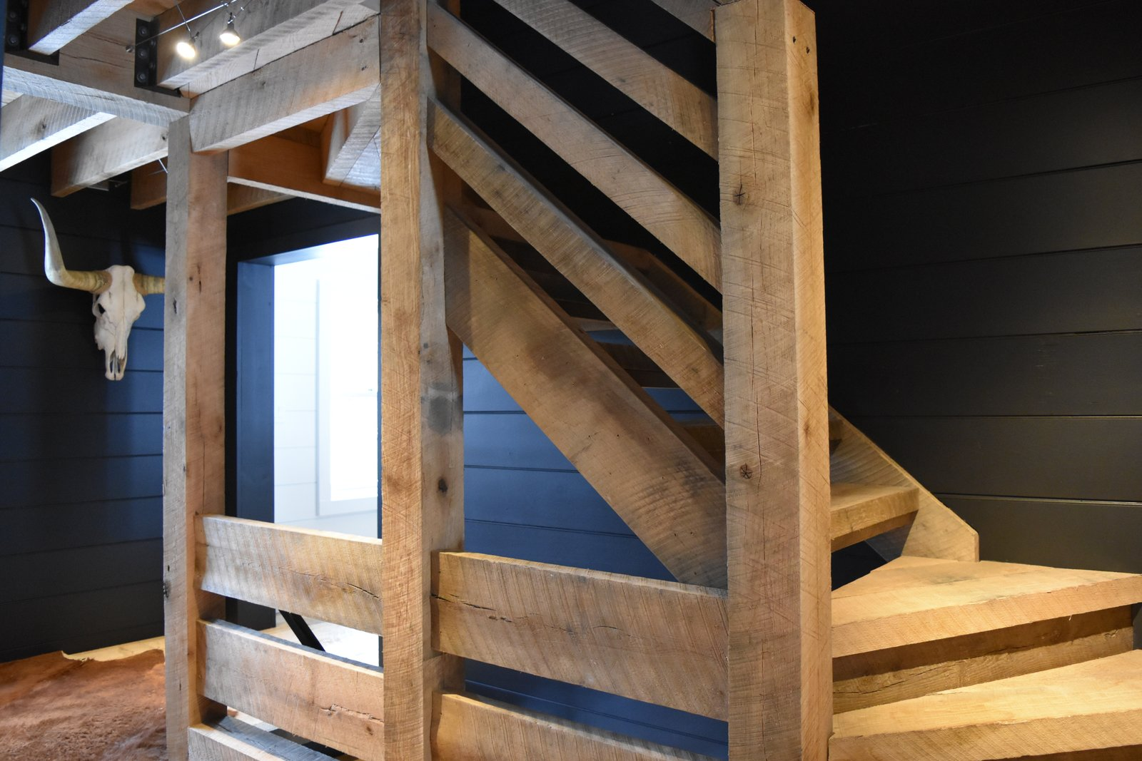 Heavy oak timber pie staircase.  The Lodge by Alpha Genesis