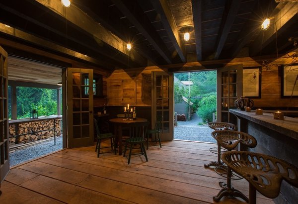 Sized for intimate gatherings, this tavern is not encumbered by its quaint size.  The tavern has hosted numerous gathering of over 40 people with caterers, bar tenders, and live music.  It has created quite the stir.  But totally worth it!   Photo 8 of The Tavern modern home