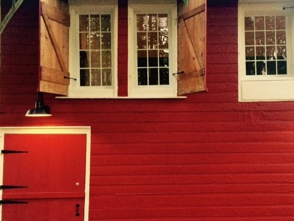 Original combination of siding.  Styles include Dutch Clapboard, English Clapboard and German Clapboard.   Photo  of The Red Barn modern home