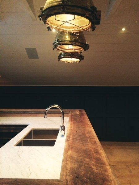 Marble work top and oak timber bar top.  Vintage Brass Nautical Lighting.   Photo 8 of The Red Barn modern home