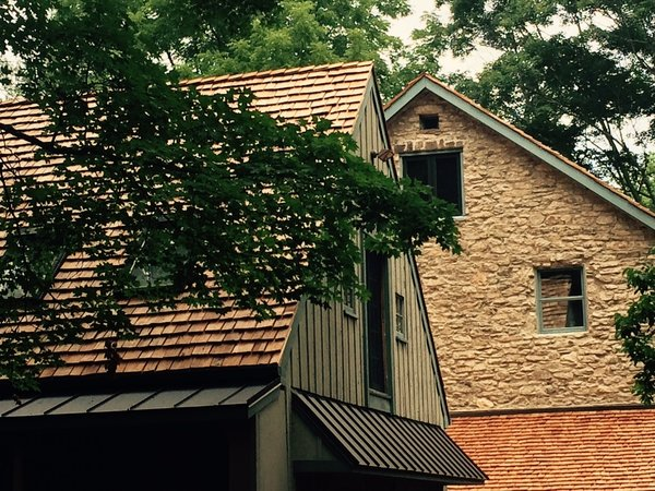 Stone Barn, circa 1745, Bucks County Stone Barn, Cedar Shake Roof, Metal Stand and Seam Roof Photo  of The Fleecydale Barn modern home
