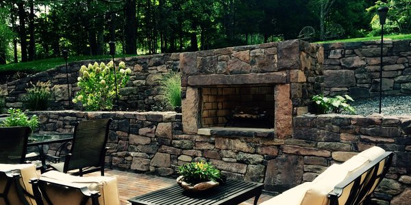 Stone Walls.  Outdoor Fireplace.  Patio and outdoor living space. Photo 3 of The Fleecydale Barn modern home
