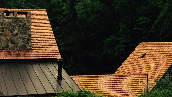 New Cedar Shake Roof against the summer forest foliage.   Photo 5 of The Fleecydale Barn modern home