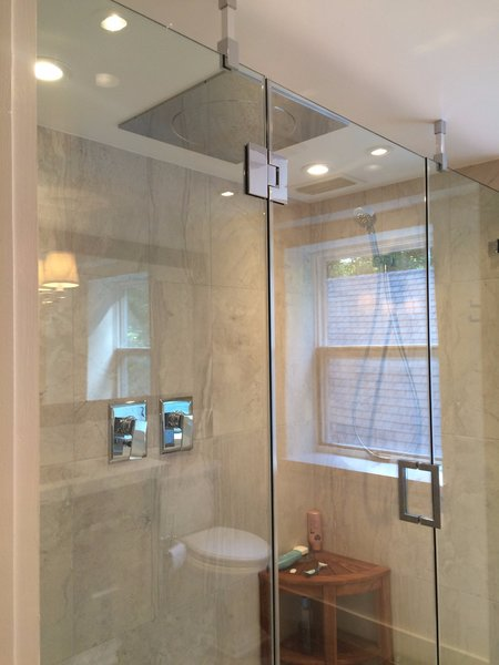 Seamless Glass.  Large rain shower.  His and Hers shower control and handhelds.     Photo 6 of The Fleecydale Barn modern home