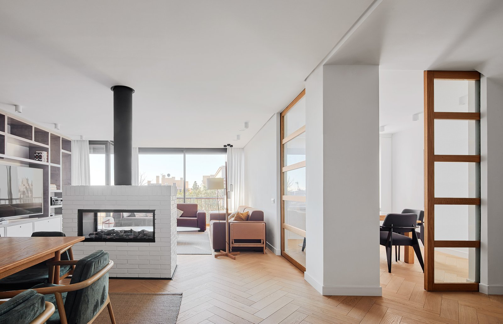 Tagged: Living Room, Two-Sided Fireplace, and Light Hardwood Floor. Beautiful Duplex in Barcelona by CONTI, CERT