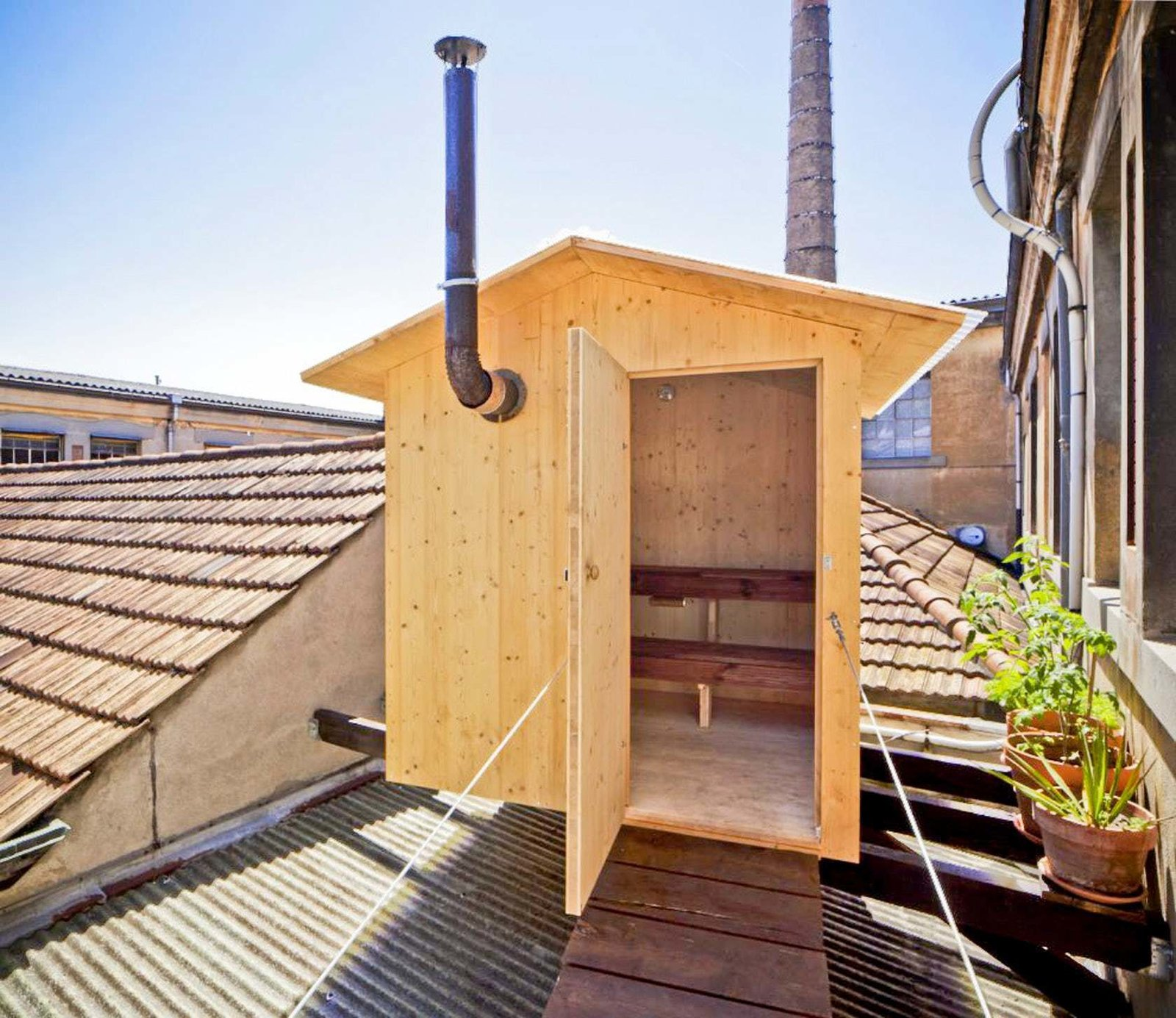 BERAU A design this sauna as a small levitating house, moored on the roof of an old factory to experiment dry heat sessions.   Photo 10 of 11 in Escape to One of These 10 Otherworldly Outdoor Saunas from Saunas
