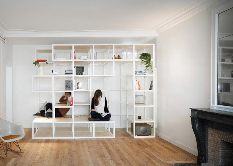Steel structure provide storage and seating at Apartment in the 6th by CUT Architectures in Paris. Tagged: Living Room.  Photo 3 of 11 in 10 Space-Saving Interiors For Multifunctional Living from Space-saving Interiors