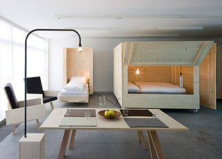 10 Space-Saving Interiors For Multifunctional Living - Photo 3 of 10 - Most pieces have wheels or have modular components, so the space can be rearranged as needed.