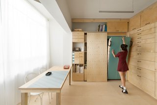 10 Space-Saving Interiors For Multifunctional Living - Photo 5 of 10 - The modular shelves and drawers were designed into four separate categories based on the measurement of each object.