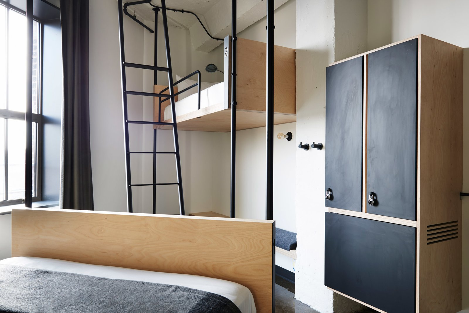 Photography is by Olivier Blouin. Tagged: Bedroom, Bunks, Bed, Wall Lighting, and Wardrobe.  Photo 4 of 7 in 6 Well-Designed Hostels For the Minimalist Traveler from Well-Designed Hostels