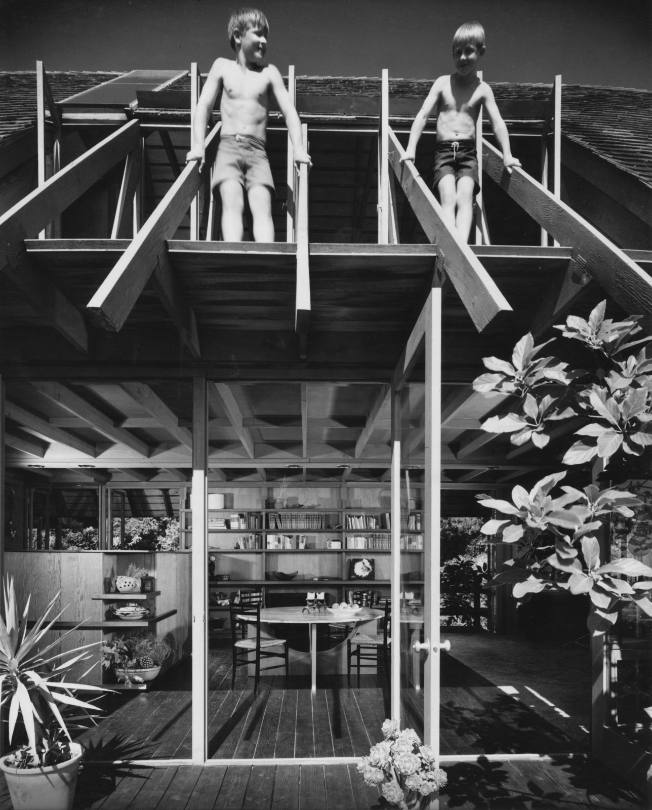 In this photo of the Diamond Street House  taken by Julius Shulman, Lyster Brock (left) stands next to his brother on his father's roof truss.  Photo 4 of 13 in A 1974 Masterpiece Is Put on the Market by a Family Friend of the Late Julius Shulman
