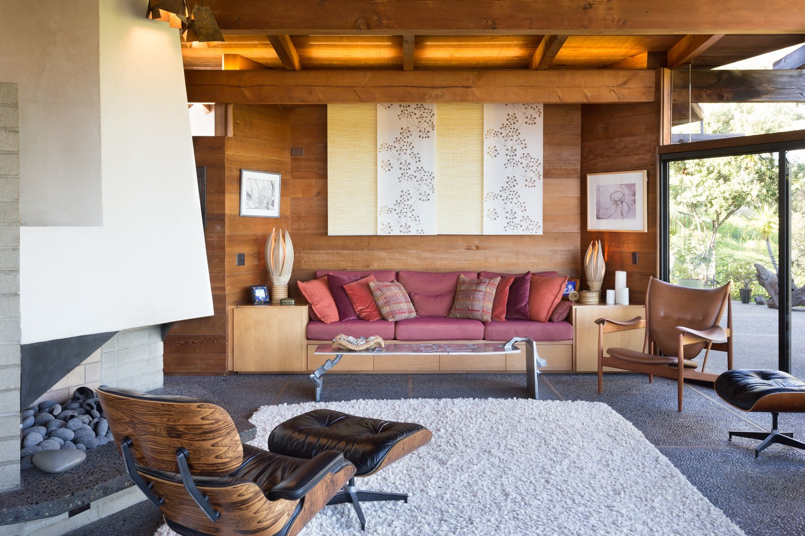 Tagged: Living Room, Wood Burning Fireplace, Bench, Chair, Coffee Tables, and Concrete Floor.  Photo 9 of 13 in A 1974 Masterpiece Is Put on the Market by a Family Friend of the Late Julius Shulman