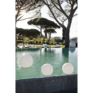 9 Ways to Create the Perfect Outdoor Lighting - Photo 2 of 9 - These portable round LED lamps by Smart & Green are made from plastic, which makes them weatherproof —a key feature for waterside lighting.