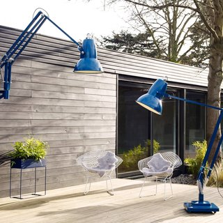 9 Ways to Create the Perfect Outdoor Lighting - Photo 5 of 9 - This outdoor space has a cozy indoor-like quality with these colorful oversized floor lamps by Anglepoise.