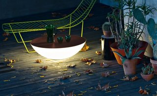 9 Ways to Create the Perfect Outdoor Lighting - Photo 6 of 9 - Designed by Jean-Marie Massaud for Foscarini, this outdoor light also acts as a surface to place drinks on or gather around.