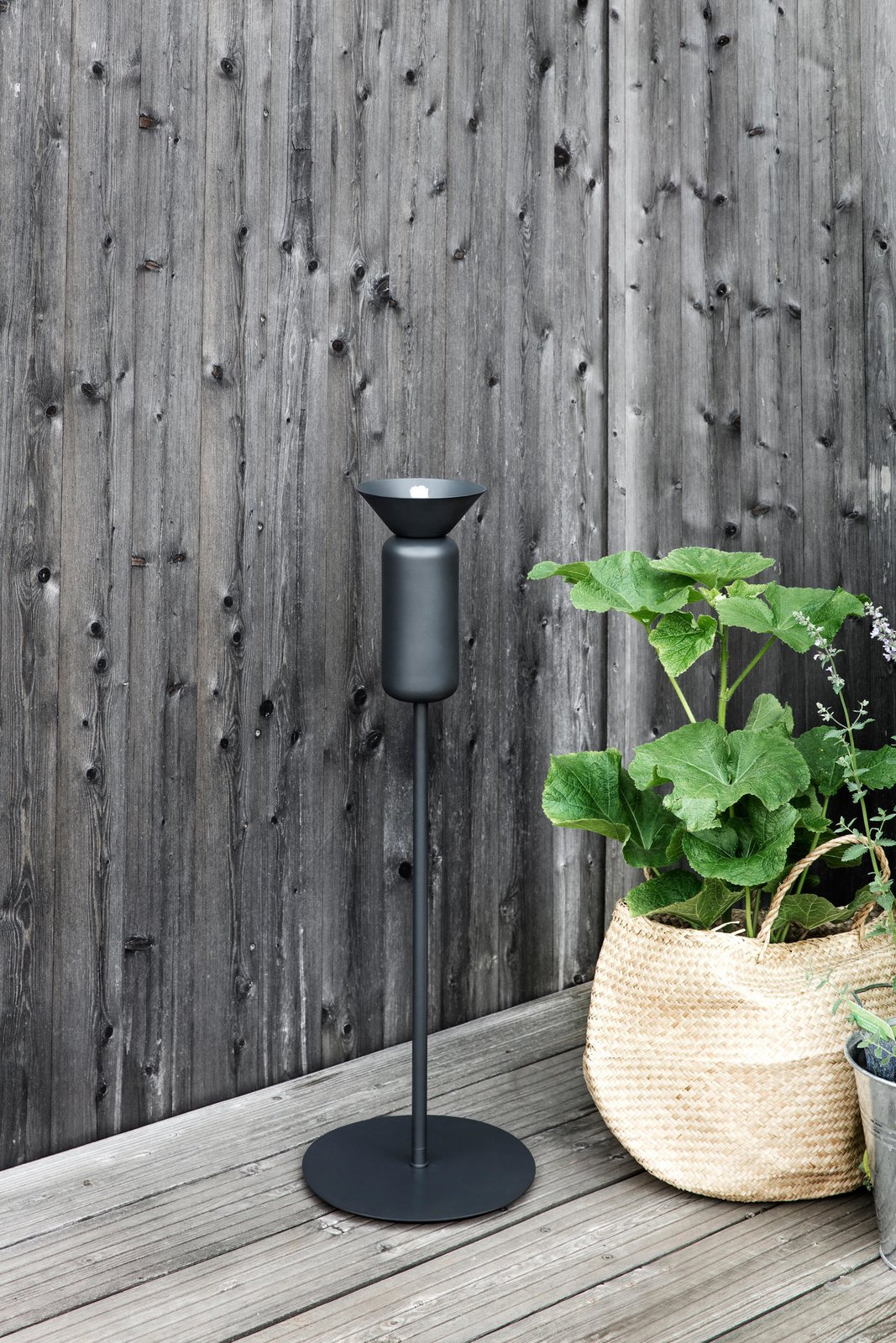 Inspired by a field of tall poppies, these outdoor oil lamps by Northern Lighting were crafted in a shape that captures the flowers' elegant stems and the crowns. 9 Ways to Create the Perfect Outdoor Lighting - Photo 9 of 10