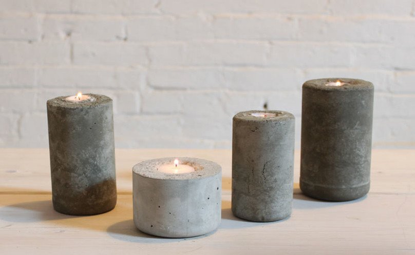These industrial-looking candle holders were made with concrete mix, cast in plastic water bottles. DIY designer Ben Uyeda of HomeMade Modern layered in different colors of concrete to create a fading, ombre effect.  Photo 2 of 10 in 9 Ways to Create the Perfect Outdoor Lighting