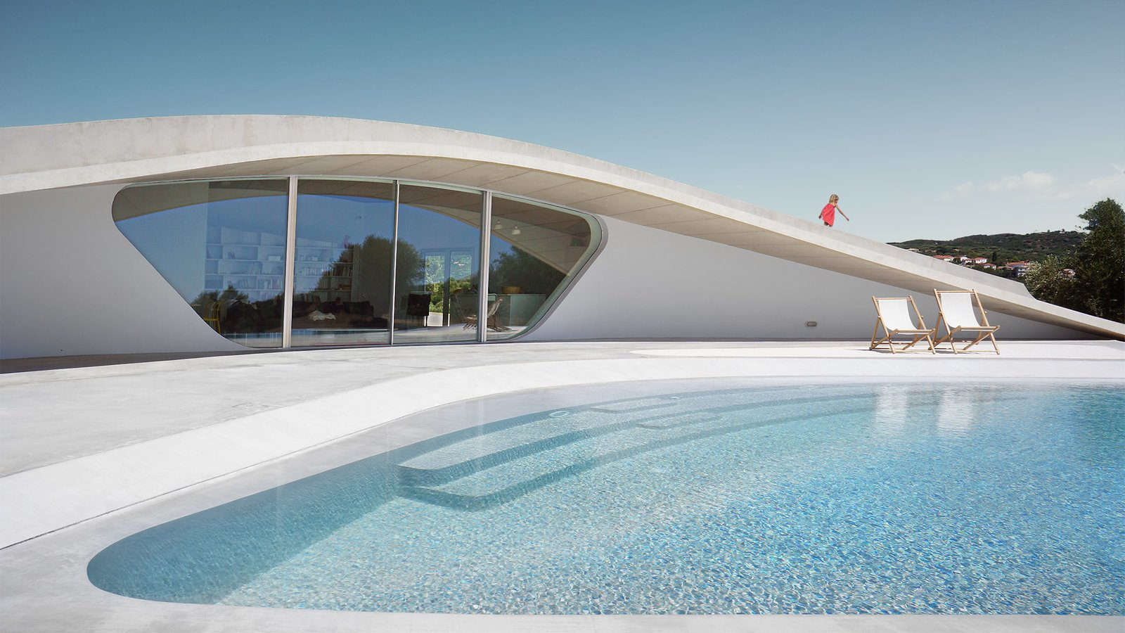Tagged: Large Pools, Tubs, Shower, Back Yard, Concrete Patio, Porch, Deck, Large Patio, Porch, Deck, Exterior, Stucco Siding Material, and House.  Photo 1 of 9 in This Y-Shaped Greek Villa Looks Like a Flying Saucer That's Embedded Into the Hills