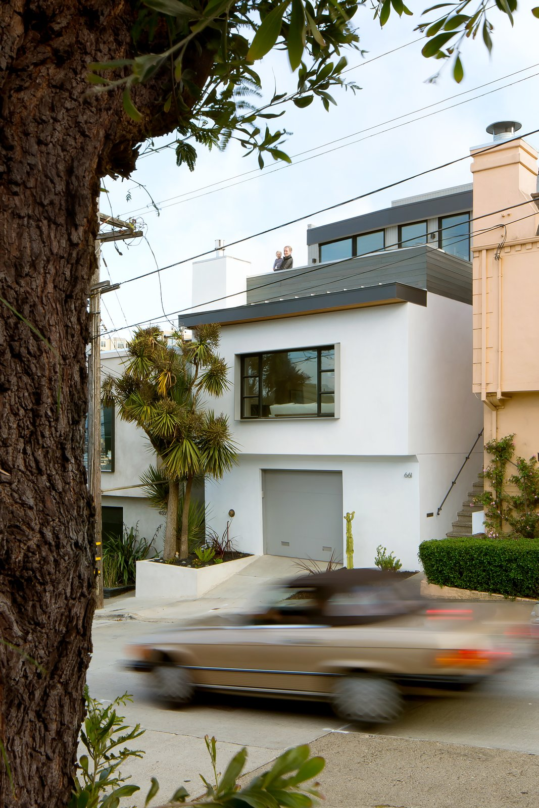 On the third story, a master suite and roof deck with city views were designed along with two bedrooms and a new bath. Tagged: Exterior, House, and Stucco.  Best Exterior Stucco Photos from Revamping the San Francisco Vernacular, Modern Design and Technology Serves A Busy Family