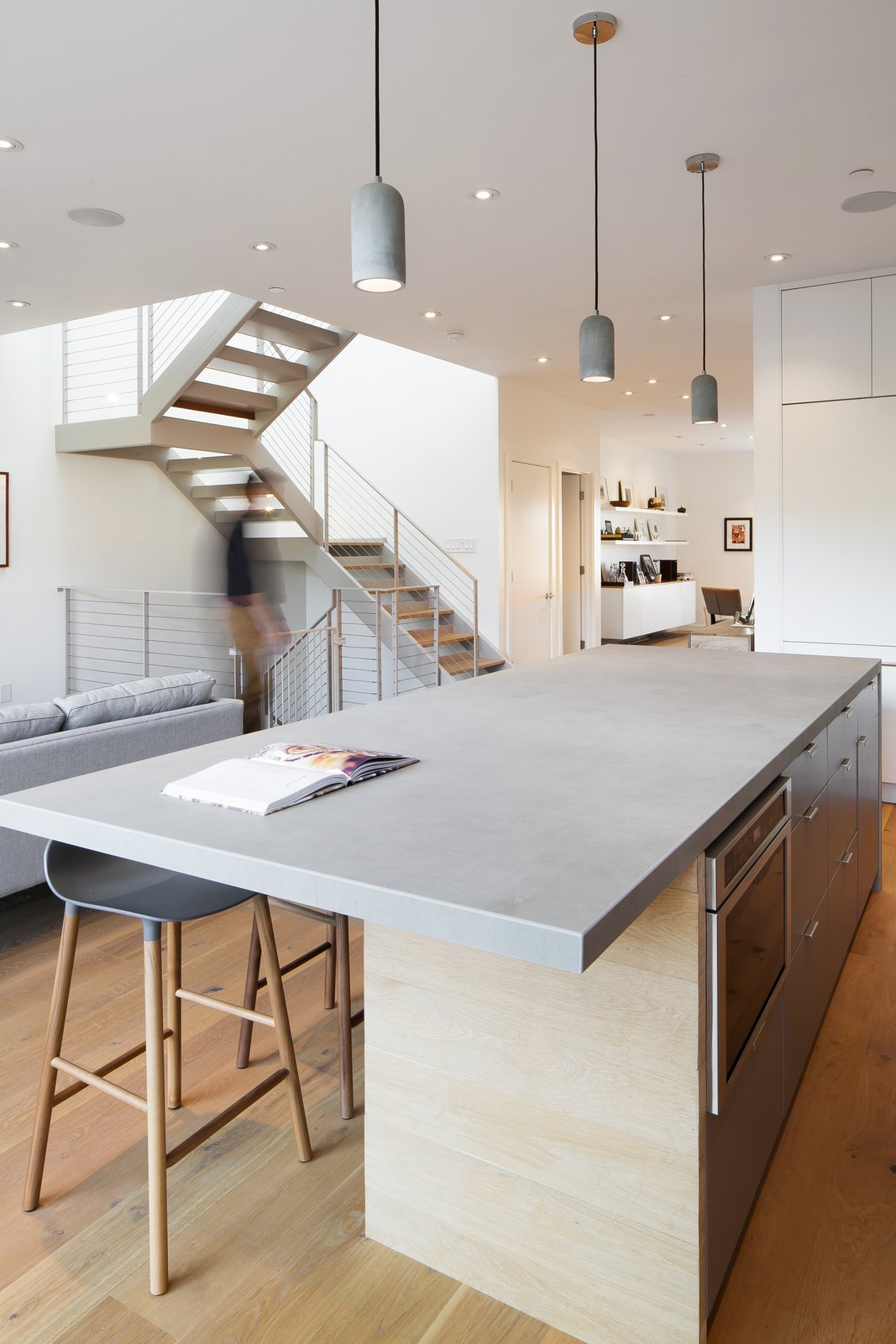 The family wanted to make their home beautiful, but also functional. When designing the renovation, they paid particular attention to making sure the common spaces could serve multiple functions and grow alongside the family. Tagged: Kitchen, Pendant Lighting, and Light Hardwood Floor.  Best Photos from Revamping the San Francisco Vernacular, Modern Design and Technology Serves A Busy Family