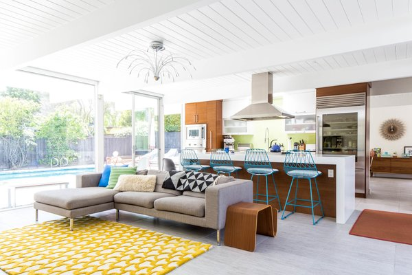 Modern home with living room, stools, end tables, sectional, and pendant lighting. Photo  of Renovated Sunnyvale Eichler