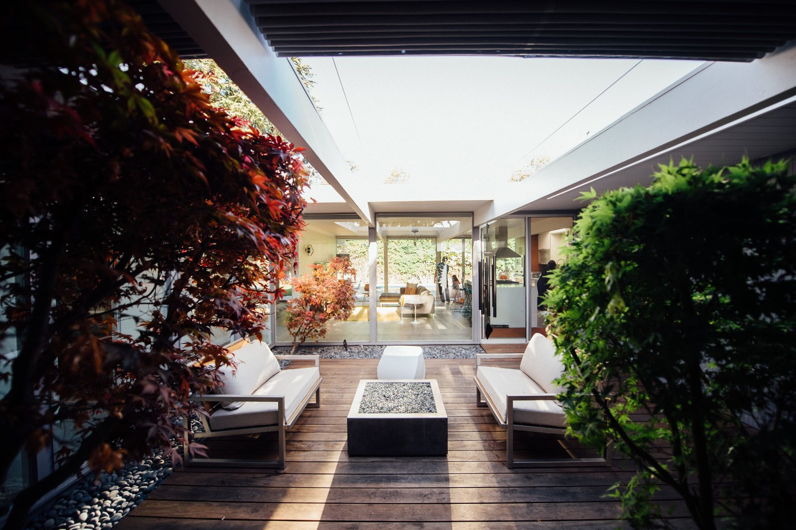 Tagged: Living Room, Coffee Tables, Stools, Sofa, and Light Hardwood Floor. An Interior Designer Launches Her Career by Renovating Her Family's Midcentury Eichler - Photo 7 of 11