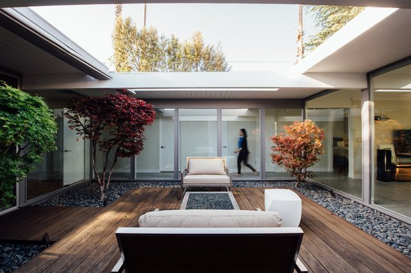 Modern home with outdoor, trees, hardscapes, wood patio, porch, deck, and small patio, porch, deck. Photo 5 of Renovated Sunnyvale Eichler